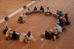 Group of people studying religion inside National Mosque of Malaysia. KUALA LUMPUR, MALAYSIA – JANUARY 05, 2015: Group of people studying religion inside Royalty Free Stock Images