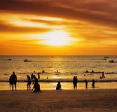 Group of people on sunset beach Stock Photo