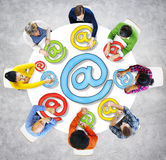Group of People and 'At' Symbol.  Royalty Free Stock Photo