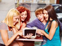 Group people with tablet computer at cafe. Royalty Free Stock Photos