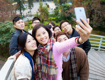 Group of people taking photo themselves Stock Photos