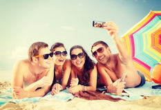 Group of people taking picture with smartphone Royalty Free Stock Photo