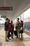 Group of people talking on railway platform Royalty Free Stock Images
