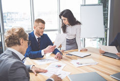 Group of people talking at workplace stock image