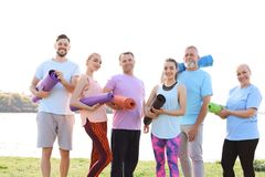 Group of people talking after yoga class near river Royalty Free Stock Photography