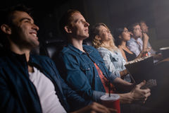 Group of people in theater watching movie Royalty Free Stock Photography