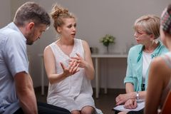 Group of people during therapy Stock Photo