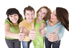 Group of people throwing out thumbs. Royalty Free Stock Images
