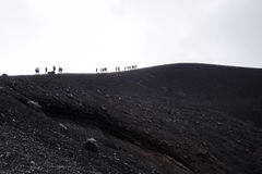 Group of people on top of a mountain on Etna Volcano Stock Photo