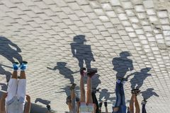 Group of people with shadows stock photo