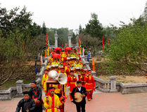 Group of people in traditional costume palanquin procession of h Royalty Free Stock Images