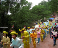 Group of people in traditional costume palanquin procession of h Stock Photos