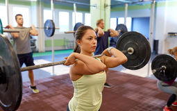 Group of people training with barbells in gym Royalty Free Stock Images