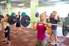 Group of people training with barbells in gym Royalty Free Stock Image