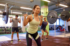 Group of people training with barbells in gym Royalty Free Stock Photo