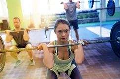 Group of people training with barbells in gym Royalty Free Stock Photography