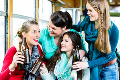 Group of people in tram bar having beer party Stock Photo