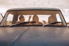 Group of females having fun traveling in a truck royalty free stock photo