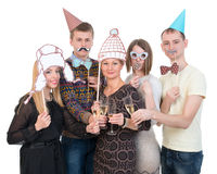 Group of people under masks on the birthday party drink cheers Royalty Free Stock Photo