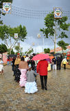 Group of people under the rain,  Fair in Seville, Andalusia, Spain Stock Image