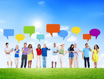 Group of People Using Devices with Speech Bubble Outdoors Stock Photos