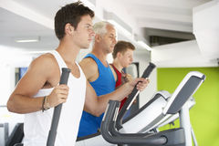 Group Of People Using Different Gym Equipment Royalty Free Stock Photos