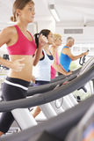Group Of People Using Different Gym Equipment Royalty Free Stock Images