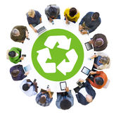 Group of People Using Digital Devices with Recycle Symbol Stock Photos