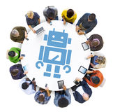 Group of People Using Digital Devices with Robot Symbol Stock Photos