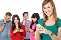 group of people using mobile phone. attractive woman at the fron stock photos