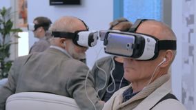 Group of people using virtual reality headset at technology show stock video footage