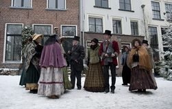 Group of people in the victorian age. Group of costumed performers in the street during the Charles Dickens festival in the dutch city centre of Deventer, the Stock Photo