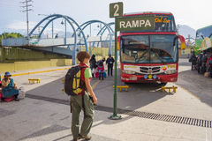 Group of people waiting for boarding regional autobus in Areuipa station, Peru. Arequipa, Peru - August 17, 2015: Group of people waiting for boarding regional Stock Photo