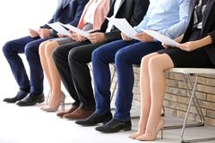 Group of people waiting for job interview. On chairs Stock Photo