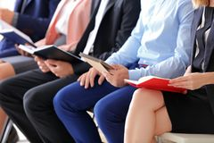 Group of people waiting for job interview. On chairs Royalty Free Stock Photo