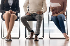 Group of people waiting for job interview, sitting on chairs stock image