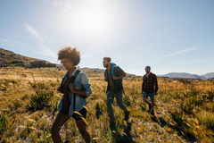 Group of people on walk through countryside royalty free stock photos
