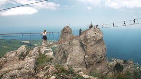 People on suspension bridge stock video footage