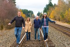 Group of people walking down train tracks Stock Image
