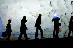 Group of people walking inside beautiful cave. Royalty Free Stock Photos