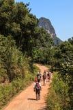 Group of people walking through limestone rock valley Stock Photos