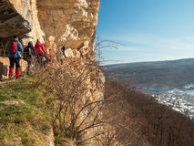 Group of people walking beside the precipice Royalty Free Stock Images