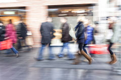 Group of people walking in shopping centre,  zoom effect, motion Stock Photo
