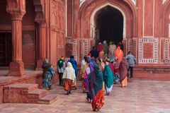 Group of people walking at Taj Mahal complex in Agra, Uttar Prad. Esh, India. Taj Mahal was designated as a UNESCO World Heritage Site in 1983 Stock Photography