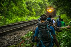 Group of People Walking Beside Train Rail Stock Images