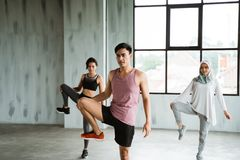 A group of people warming up before doing core gymnastics royalty free stock image