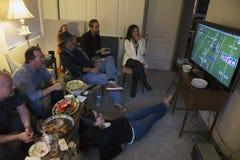 Group of people watch NFL Superbowl XLVIII on television, Feb. 2, 2014, Denver Broncos vs. Seattle Seahwaks royalty free stock image