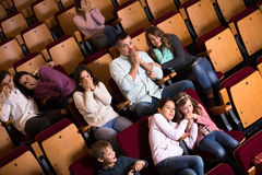 Group people watching movie night for horror. In cinema stock photography