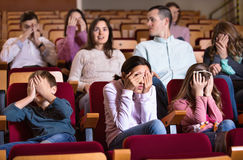 Group of people watching scary movie Stock Photography