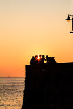 Group of People Watching Sunset in Riomaggiore Royalty Free Stock Photography